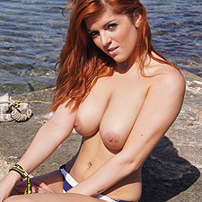 Busty redhead Rosie