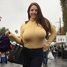 Angela White braless in a sweater