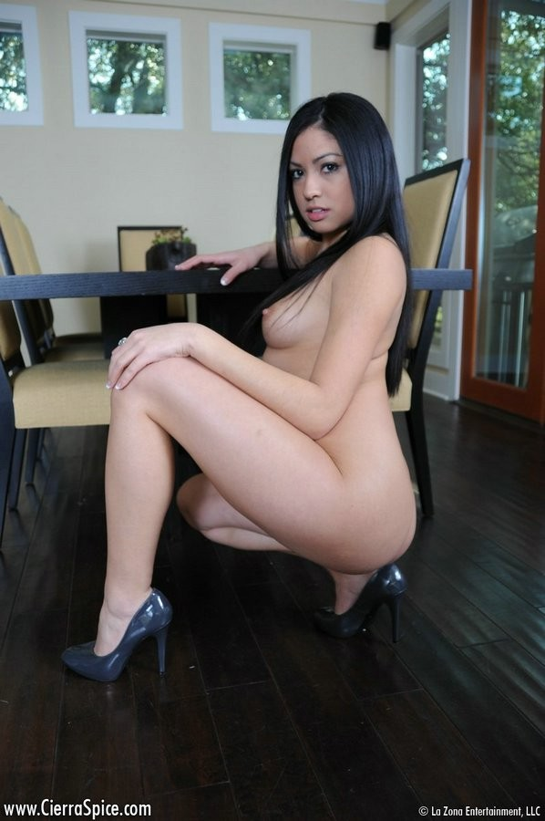 sexy mexican women stradiling chair