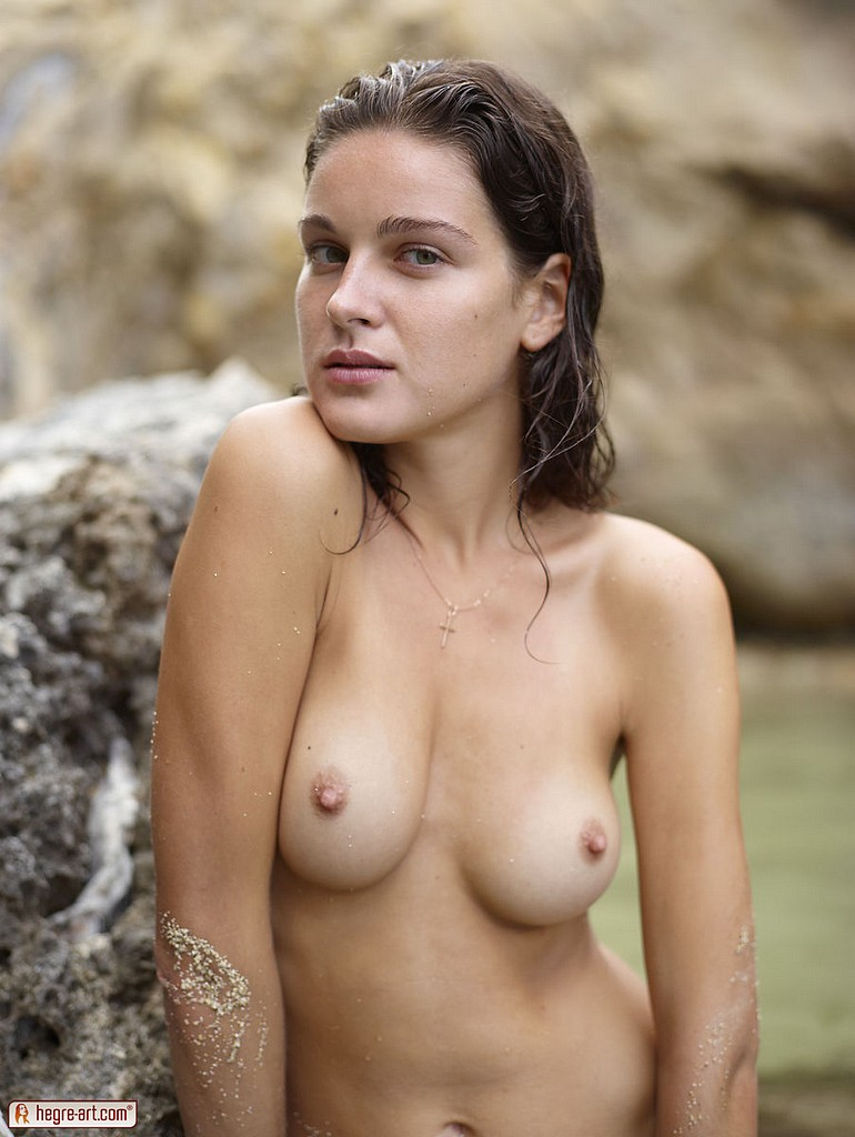Beach babe Zaika gets her nude body wet and sandy ...