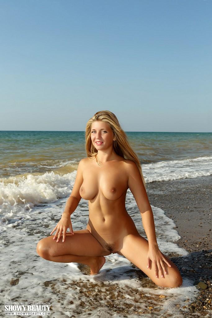 Topless & nude beauties on the beach